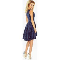 Kali Wyjątkowa sukienka z dłuższym tyłem - żakard kółeczka GRANATOWA. Niebieskie sukienki marki numoco, na imprezę, s, w kwiaty, z jeansu, sportowe, sportowe. Za 199,00 zł.