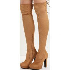 Beżowe Kozaki Michelle. Czarne buty zimowe damskie marki Kazar, z futra, przed kolano, na wysokim obcasie, na koturnie. Za 119,99 zł.