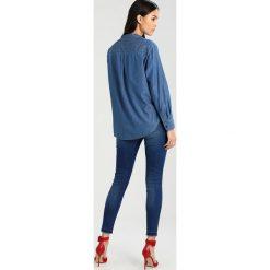 Lee SCARLETT HIGH Jeans Skinny Fit worn out misfit. Niebieskie jeansy damskie marki Lee, z bawełny. W wyprzedaży za 287,10 zł.
