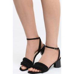 Czarne Sandały That's Crazy. Czarne sandały damskie na słupku marki Born2be, z materiału, na wysokim obcasie. Za 69,99 zł.