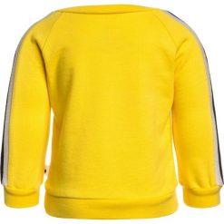 Noé & Zoë BABY SPORTY Bluza yellow. Żółte bejsbolówki męskie Noé & Zoë, z bawełny. Za 209,00 zł.