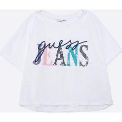Guess Jeans - Top dziecięcy 118-175 cm. Niebieskie bluzki dziewczęce bawełniane marki Guess Jeans, z obniżonym stanem. Za 99,90 zł.