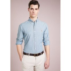Polo Ralph Lauren SLIM FIT Koszula medium wash. Szare koszule męskie slim marki Polo Ralph Lauren, l, z bawełny, button down, z długim rękawem. Za 619,00 zł.