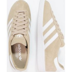 Adidas Originals MÜNCHEN Tenisówki i Trampki raw gold/footwear white/gold metallic. Szare tenisówki męskie marki adidas Originals, z gumy. W wyprzedaży za 359,20 zł.