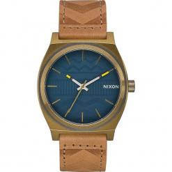 """Zegarek kwarcowy """"Time Teller"""" w kolorze jasnobrązowo-złotym. Brązowe, analogowe zegarki męskie Nixon, ze stali. W wyprzedaży za 159,95 zł."""