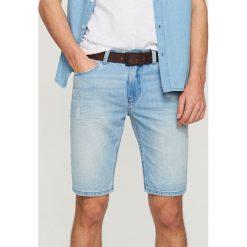 Bermudy męskie: Jeansowe szorty z przetarciami - Niebieski