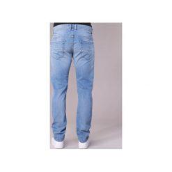 Jeansy slim fit Diesel  THOMMER. Niebieskie jeansy męskie relaxed fit marki Diesel. Za 495,20 zł.
