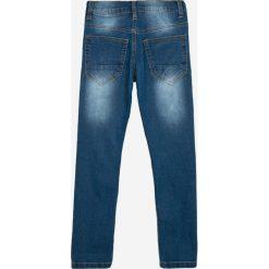 Blukids - Jeansy dziecięce 134-164 cm. Niebieskie chinosy chłopięce Blukids, z bawełny. W wyprzedaży za 39,90 zł.