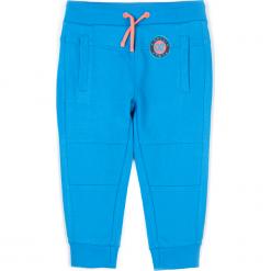 Spodnie. Niebieskie chinosy chłopięce HEY BOY, z nadrukiem, z bawełny. Za 34,90 zł.