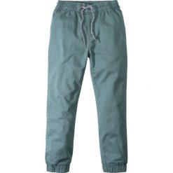 Odzież dziecięca: Luźniejsze spodnie ocieplane z miękką bawełnianą podszewką bonprix ciemnozielony