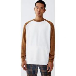 Bluza z kontrastowymi rękawami raglanowymi. Czerwone bluzy męskie rozpinane marki KALENJI, m, z elastanu, z długim rękawem, długie. Za 69,90 zł.