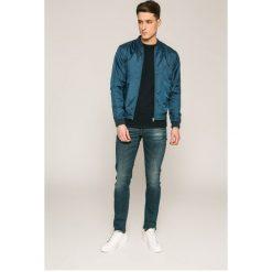 G-Star Raw - Jeansy 3301. Niebieskie jeansy męskie slim marki G-Star RAW. W wyprzedaży za 359,90 zł.