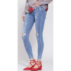 Niebieskie Jeansy Daisy Flower. Niebieskie jeansy damskie marki other. Za 94,99 zł.