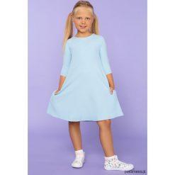 Sukienka trapezowa, model 24, j.niebieski. Niebieskie sukienki dziewczęce z falbanami Pakamera, z tkaniny, eleganckie. Za 89,00 zł.
