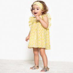 Komplet dla niemowląt sukienka i opaska 1 miesiąc - 3 lata. Żółte sukienki dziewczęce marki La Redoute Collections, z bawełny, bez rękawów. Za 88,16 zł.