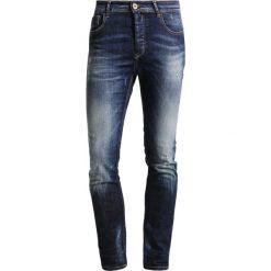 Benetton Jeans Skinny Fit dunkelblau. Niebieskie rurki męskie Benetton. W wyprzedaży za 175,20 zł.