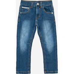 Blukids - Jeansy dziecięce 98-128 cm. Niebieskie spodnie chłopięce Blukids, z bawełny. W wyprzedaży za 29,90 zł.