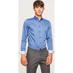 Koszula z mikroprintem slim fit - Granatowy. Niebieskie koszule męskie na spinki Reserved, l. Za 119,99 zł.