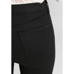 Topshop JAMIE NEW Jeans Skinny Fit black. Czarne jeansy damskie marki Topshop, z bawełny. Za 229,00 zł.