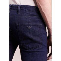 Emporio Armani Jeansy Slim Fit dark blue. Szare jeansy męskie relaxed fit marki Emporio Armani, l, z bawełny, z kapturem. W wyprzedaży za 401,40 zł.