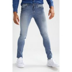 Cheap Monday TIGHT  Jeans Skinny Fit strong blue. Niebieskie rurki męskie marki Tiffosi. W wyprzedaży za 167,20 zł.