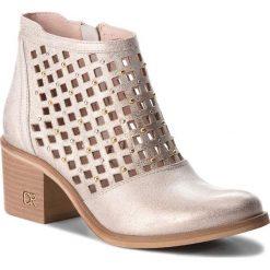 Botki CARINII - B4315  F76-000-000-861. Żółte buty zimowe damskie marki Carinii, z materiału, na obcasie. W wyprzedaży za 199,00 zł.