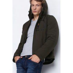 Ciemnozielona Kurtka Correlation. Czarne kurtki męskie pikowane marki Born2be, l, z aplikacjami, z dresówki. Za 159,99 zł.