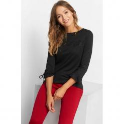 Koszulka z koronkową wstawką. Czarne bluzki longsleeves marki Orsay, xs, w jednolite wzory, z dzianiny, z falbankami. Za 69,99 zł.