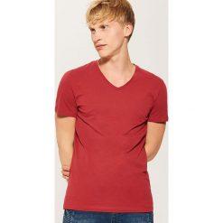 T-shirt basic - Czerwony. Czarne t-shirty męskie marki KIPSTA, z poliesteru, do piłki nożnej. Za 25,99 zł.