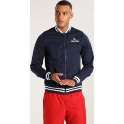 Lacoste Sport Kurtka sportowa navy blue/white. Niebieskie kurtki sportowe męskie Lacoste Sport, m, z materiału. W wyprzedaży za 389,25 zł.