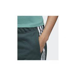 Spodnie treningowe adidas  Spodnie dresowe z mankietami. Zielone spodnie sportowe damskie marki Adidas, z dresówki. Za 174,30 zł.