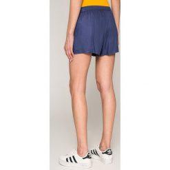 Roxy - Szorty. Pomarańczowe szorty damskie Roxy, z tkaniny, casualowe. W wyprzedaży za 119,90 zł.