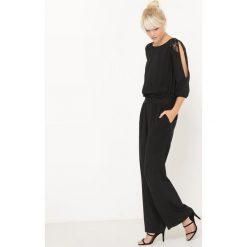 Kombinezony damskie: Kombinezon ze spodniami z koronkowymi detalami