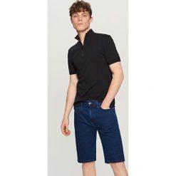 Jeansowe szorty - Niebieski. Niebieskie spodenki jeansowe męskie marki Reserved. W wyprzedaży za 69,99 zł.