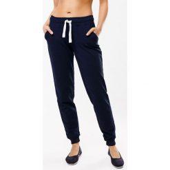 Damskie spodnie dresowe MF Blue 01. Niebieskie bryczesy damskie marki Astratex, z dresówki. Za 95,99 zł.