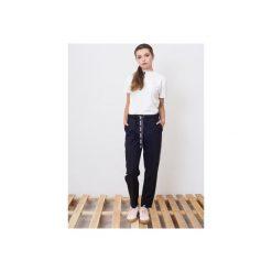Bryczesy damskie: Spodnie z lampasem