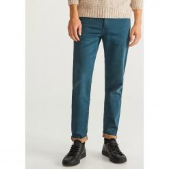 Jeansy slim fit dzianinowe - Turkusowy. Niebieskie jeansy męskie regular Reserved. Za 149,99 zł.