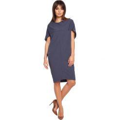 GABRIELA Sukienka tunika geometryczne cięcia - niebieska. Niebieskie sukienki marki numoco, na imprezę, s, w kwiaty, z jeansu, sportowe, sportowe. Za 129,99 zł.