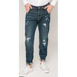 G-Star Raw - Jeansy Arc. Niebieskie jeansy męskie z dziurami marki G-Star RAW. W wyprzedaży za 399,90 zł.