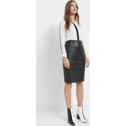 Ołówkowa spódnica. Czarne spódniczki ołówkowe Orsay, z poliesteru. Za 79,99 zł.