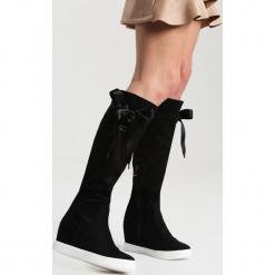 Czarne Kozaki Heart Of Silver. Czarne buty zimowe damskie vices, na koturnie. Za 119,99 zł.