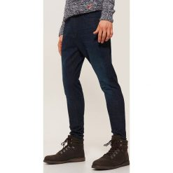 Jeansy slim fit - Granatowy. Niebieskie jeansy męskie relaxed fit House, z jeansu. Za 129,99 zł.