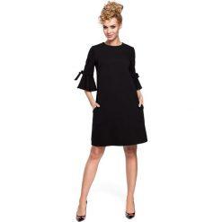 DESTINY Mini sukienka z falbanką na rękawach - czarna. Czarne sukienki dzianinowe Moe, z falbankami, mini. Za 136,99 zł.