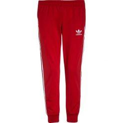 Chinosy chłopięce: adidas Originals PANTS Spodnie treningowe scarlet