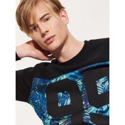 Bluza z tropikalnym printem - Czarny. Czarne bluzy męskie rozpinane marki House, l. Za 79,99 zł.