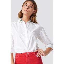MANGO Koszula Palmeras - White. Białe koszule damskie marki Mango, z haftami. W wyprzedaży za 85,37 zł.
