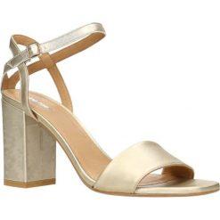 Sandały SUI. Brązowe sandały damskie na słupku marki Gino Rossi, w paski, ze skóry, na wysokim obcasie. Za 249,90 zł.