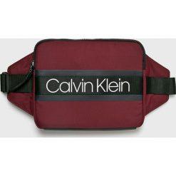 Calvin Klein - Nerka. Brązowe walizki marki Calvin Klein, w paski, z materiału, małe. Za 279,90 zł.