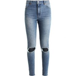 Cheap Monday HIGH SPRAY Jeans Skinny Fit cut off blue. Niebieskie boyfriendy damskie Cheap Monday. Za 249,00 zł.