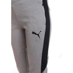 Puma EVOSTRIPE MOVE PANTS  Spodnie treningowe medium gray heather. Różowe spodnie chłopięce marki Puma, na lato, z tkaniny, sportowe. W wyprzedaży za 152,10 zł.